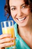Happy woman orange juice stock photos