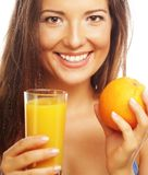 Happy woman with orange juice Royalty Free Stock Photos