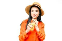 Woman drinks fresh juice fruit, white background Royalty Free Stock Photography