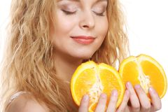 Happy woman with orange Stock Photo