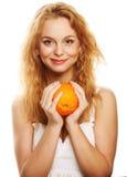 Happy woman with orange Royalty Free Stock Photo