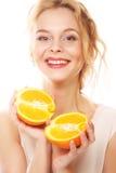 Happy woman with orange Stock Photography