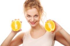 Happy woman with orange Stock Photos