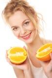 Happy woman with orange Royalty Free Stock Photos