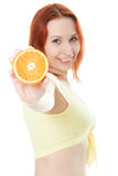Happy woman with oranges. In her hands Royalty Free Stock Photo