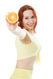Happy woman with oranges. In her hands Stock Photography