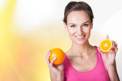 Happy woman with oranges Royalty Free Stock Image