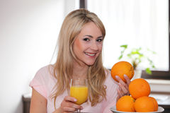 Happy woman with oranges and juice royalty free stock photo