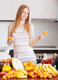 Happy woman with  oranges and other fruits Stock Images