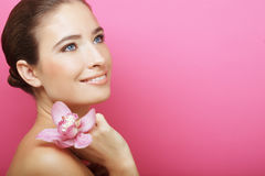Happy woman with orchid flower Royalty Free Stock Photography