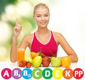 Happy woman with organic food and vitamins Stock Photo