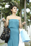 Happy woman out shopping Royalty Free Stock Images