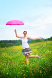 Happy woman outdoor with an umbrella Royalty Free Stock Photo