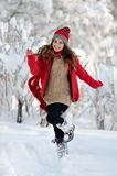 Happy woman outdoor in winter enjoying the snow Royalty Free Stock Photo