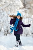 Happy woman outdoor in winter enjoying the snow Stock Photo