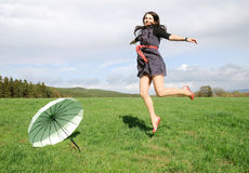 Happy woman outdoors Stock Image