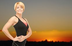 Happy woman outdoors over sunset skyline Stock Photos