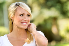 Happy Woman Outside. Blonde happy woman outside in nature royalty free stock images