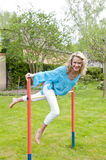 Happy woman on outside high bar Royalty Free Stock Photo