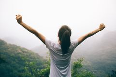 Woman with outstretched arms enjoying the view Stock Photography