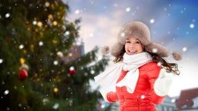Happy woman over christmas tree in tallinn royalty free stock photos