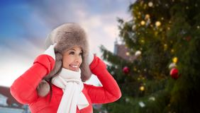Happy woman over christmas tree in tallinn royalty free stock photography
