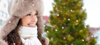 Happy woman over christmas tree in tallinn royalty free stock image
