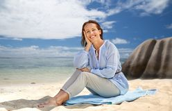 Happy woman over seychelles island tropical beach stock photo