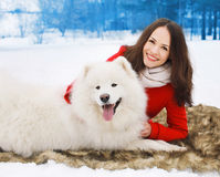 Happy woman owner having fun with white Samoyed dog outdoors Royalty Free Stock Images