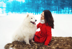Happy woman owner having fun with white Samoyed dog outdoors Royalty Free Stock Image