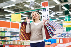 Happy woman with packages for purchases Stock Photography