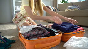 Happy woman packing a luggage for a journey. Tame lapse. stock video