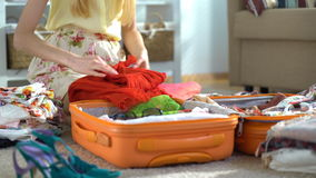Happy woman packing a luggage for a new journey stock video