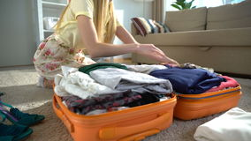 Happy woman packing a luggage for a new journey stock footage