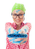 Happy woman with a paint brush holding it out Royalty Free Stock Image