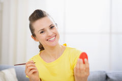 Happy woman painting on Easter egg Royalty Free Stock Photo