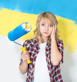 Happy woman painting wall at room Stock Image