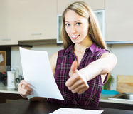 Happy woman with papers Royalty Free Stock Image