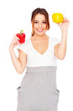 Happy woman with paprikas Stock Photography