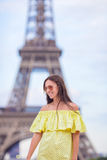Happy woman in Paris background the Eiffel tower Royalty Free Stock Photography
