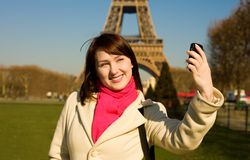 Happy woman in Paris using phone camera Stock Photos