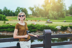 Happy woman in a park Royalty Free Stock Photography