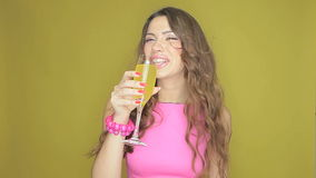 Happy woman partying with a drink in her hand Royalty Free Stock Image