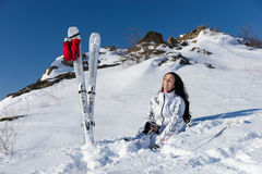 Happy Woman Pausing from Skiing to Enjoy Warm Sun Royalty Free Stock Image
