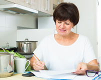 Happy woman paying bills Stock Photography