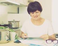 Happy woman paying bills Stock Photo