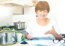 Happy woman paying bills Royalty Free Stock Photos