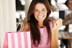 Happy woman paying with credit card Royalty Free Stock Images