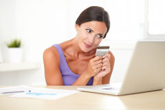 Happy woman paying with electronic wallet Stock Photo