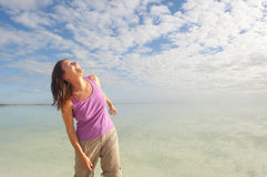 Happy woman at peaceful ocean background Stock Photo